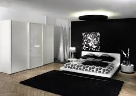 Round Fur Rug by Big White Wardrobe Inside Black And White Bedroom With Chic Bed