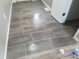 bathroom vinyl flooring ideas 12 in x 24 in coastal grey vinyl tile flooring 29 sq ft