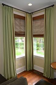 window window blinds costco with green curtains and picture