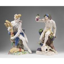 pair of nymphenburg porcelain figurines of bacchus and ceres after