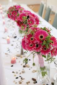 Table Vase Decorations Pink Daisy Bouquets In Vases Decorate A Wedding Reception Table