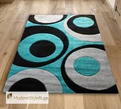 red and aqua blue rug and teal blue swirls with grey funky