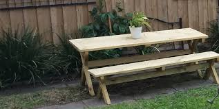 How To Build Outdoor Furniture by Build A Picnic Table With Crossed Legs Page 1