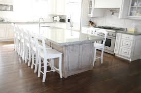 White Laminate Wood Flooring White Kitchen With Wood Floor Enchanting Home Design