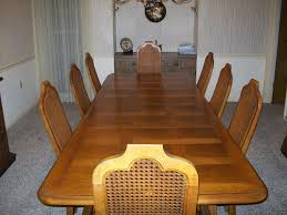 american heritage dining room table with eight chairs and two