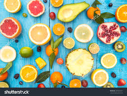mix colored fruits on white wooden stock photo 369905297