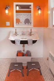 orange bathroom ideas orange and gray boys bathroom with gray stools contemporary