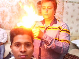 indian barber uses fire to cut people u0027s hair business insider