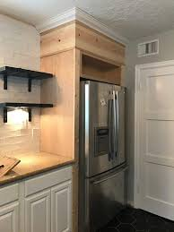 how to build a cabinet around a refrigerator we ve got the fridge surrounded kitchen diy makeover diy