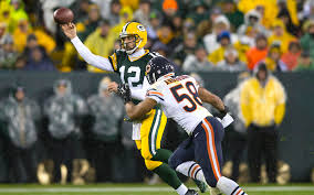 aaron rodgers injures wrist after fumbled snap returns to