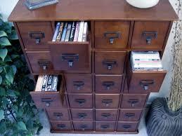 leslie dame media storage cabinet new living rooms walnut finish library design dvd storage for leslie