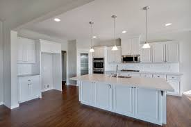 this exquisite classic style kitchen features white maple cabinets