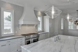 White Kitchen Brick Tiles - white and gray kitchen with gray brick tiles transitional kitchen