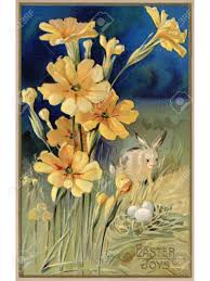 a vintage easter postcard of spring flowers a rabbit and eggs