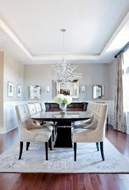 Transitional Dining Room With Elegant Solid Back Parsons Chairs - Transitional dining room chairs
