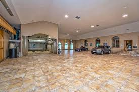 contemporary garage with terracotta tile floors arched window in