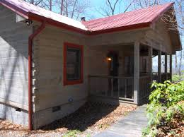 Metal Roof On Houses Pictures by Log Cabin With A Red Metal Roof Bear Claw Cabin Log Cabins