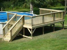 outstanding wooden gate for pool deck with white resin stackable
