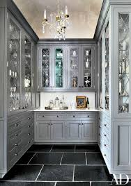 architectural digest pinteres no to the gray and a different light fixture please something from charles edwards then it will be perfect love the slate floor pantry cabinets