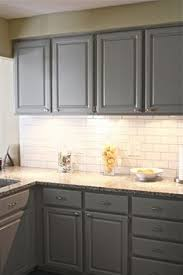 Kitchen Counter Tile - grey cabinets black appliances silver hardware full tile