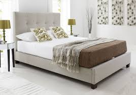 elegant upholstered bedstead with hidden storage tall buttoned