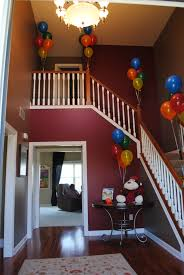 curious george party decorations staircase with balloons