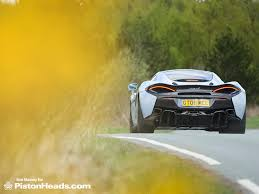 All New Mclaren 570gt Gets Geneva Unveil Pictures Auto Mclaren 570gt Vs Porsche 911 Turbo S Vs Audi R8 Pistonheads