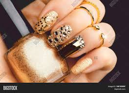 golden nail art manicure holiday style bright manicure with gems