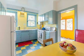 blue kitchen cabinets and yellow walls colorful west mt airy home is a delight asks 365k