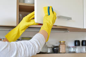 what should you use to clean wooden kitchen cabinets how to clean sticky grease kitchen cabinets ovenclean