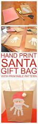 hand print santa christmas gift bag w printable pattern santa