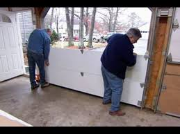 How To Plumb A House by How To Install A Garage Door This Old House Youtube