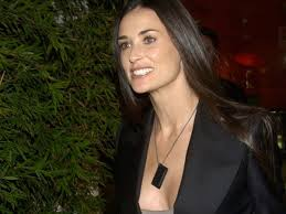 hair style for women age 48 with long curly hair how does demi moore stay looking so good at age 48 leo sigh