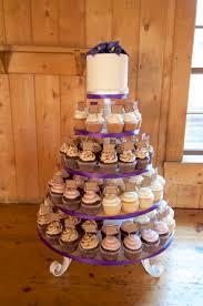 plane jane buttercream cake topper with purple ribbon on a wedding