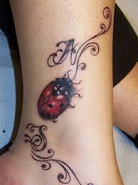 Ladybug And Flower Tattoos - ladybug on flower tattoo on wrist real photo pictures images