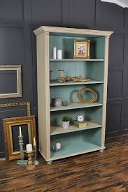 this farmhouse pine bookcase has been painted in annie sloan