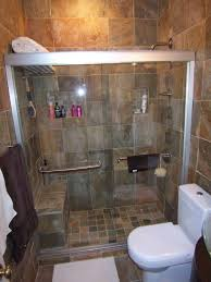 bathroom features a nice combination of dark tiles the shower area