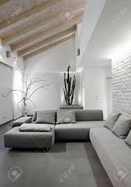 modern gray sofa in living in a modern attic room stock photo