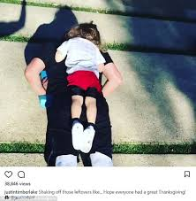 justin timberlake does push ups with silas on his back daily