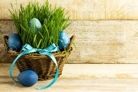 blue easter eggs blue easter eggs in a basket with grass wooden background