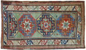 tappeti kazak kazak antico dal fondo verde brillante morandi tappeti