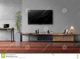 led tv on gray wall color with wooden table media furniture stock