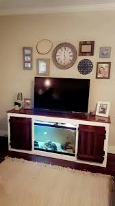 old entertainment center into a fish tank stand ideas