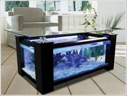 aquarium design under glass table living room with gray chair also