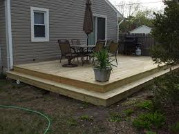 how to build ground level wood deck without posts contemporary
