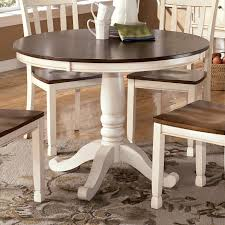 two tone round table with pedestal base by signature design by