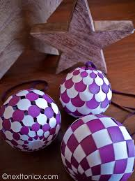 woven paper baubles next to nicx