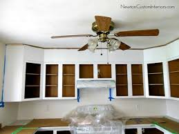 what of paint to use on oak cabinets how to paint oak cabinets tips for filling in oak grain
