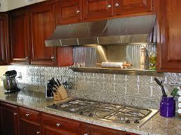 granite full backsplash multi coloured wall tiles kitchen faucet