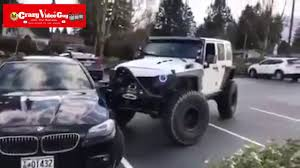 crashed white jeep jeep pushes bmw into parking space youtube